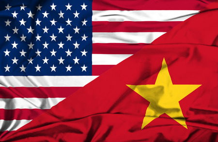 vietnam war: Waving flag of Vietnam and USA Stock Photo