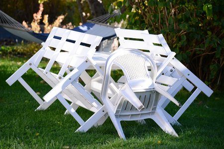 Chairs and table in garden photo