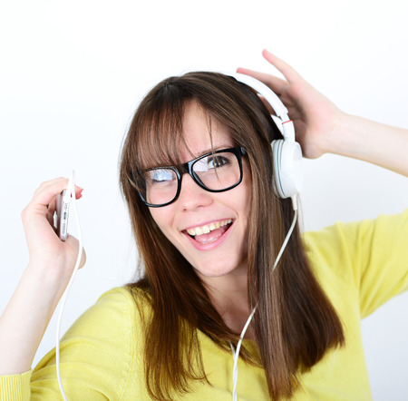 Woman dancing with earbuds  headphones listening to music on mp3 player photo