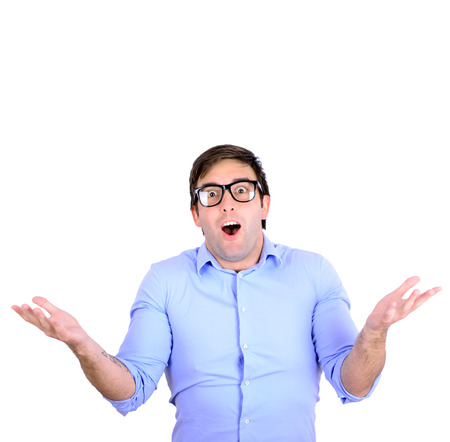 insensitive: Portrait of confused clueless young man against white background