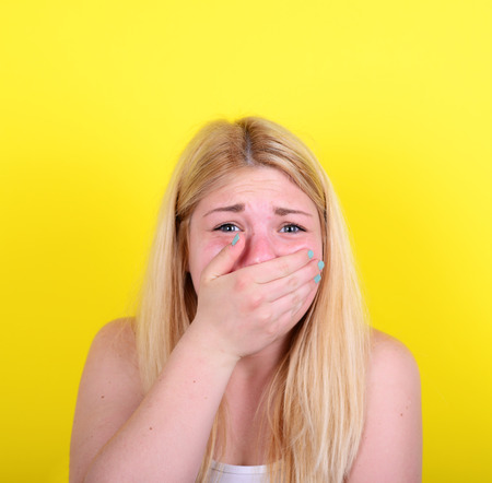scared girl: Portrait of scared girl against yellow background
