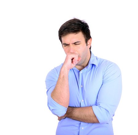 Portrait of young man coughing isolated on white Standard-Bild