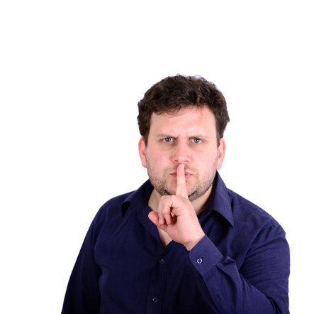 Portrait of man with gesture for silence against red background