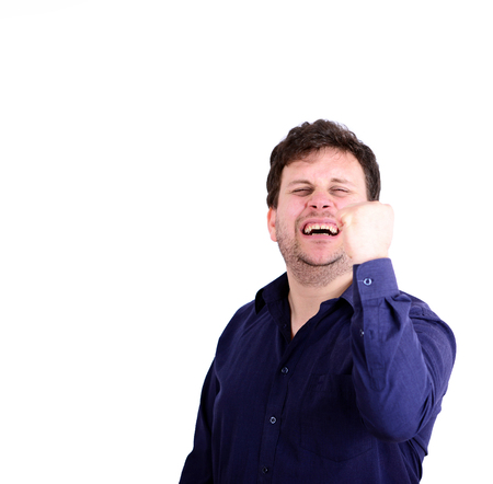 Portrait of smiling chubby man with fists up isolated on white photo