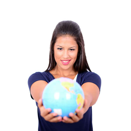 Portrait of beautiful young woman holding globe in hands against white background