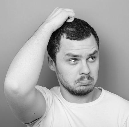 stumped: Portrait of funny cluelles man - Monocrome or black and white portrait