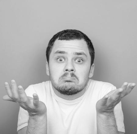 monocrome: Portrait of funny cluelles man - Monocrome or black and white portrait