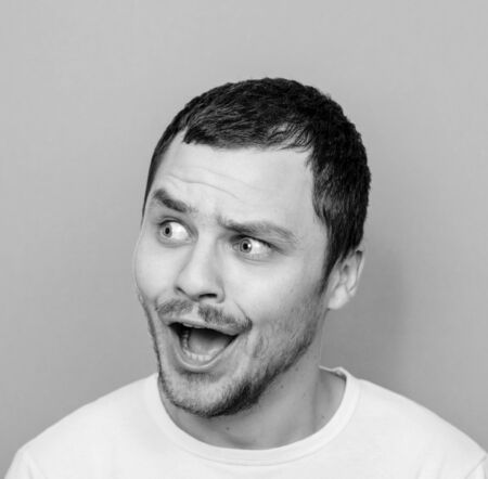 monocrome: Portrait of man with funny face - Monocrome or black and white portrait Stock Photo