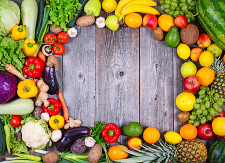 Collection of fresh Fruit and vegetables on wooden table in form of frame - High quality studio shot
