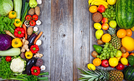 fruits background: Huge group of fresh vegetables and fruit on wooden background - Vegetables VS Fruit - High quality studio shot