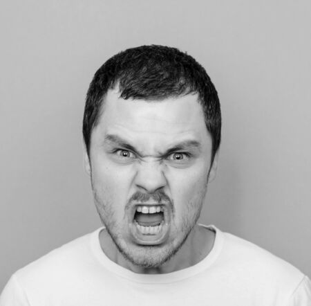monocrome: Portrait of angry man screaming - Monocrome or black and white portrait