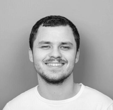 monocrome: Portrait of handsome man smiling - Monocrome or black and white portrait Stock Photo