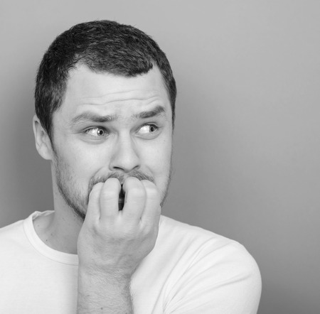 monocrome: Portrait of man biting nails - Monocrome or black and white portrait