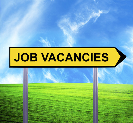 Conceptual arrow sign against beautiful landscape with text - JOB VACANCIES photo