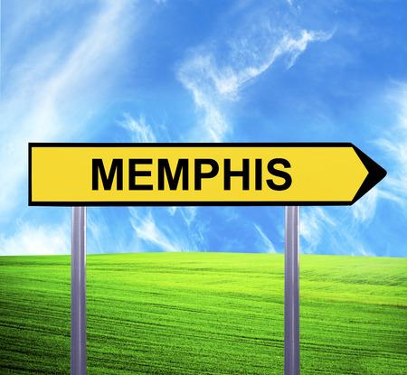 graceland: Conceptual arrow sign against beautiful landscape with text - MEMPHIS Stock Photo