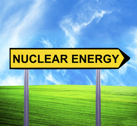 nuclear fission: Conceptual arrow sign against beautiful landscape with text - NUCLEAR ENERGY