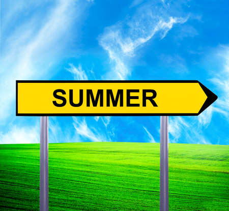 directing: Conceptual arrow sign against beautiful landscape with text - SUMMER Stock Photo