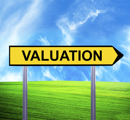 valuation: Conceptual arrow sign against beautiful landscape with text - VALUATION