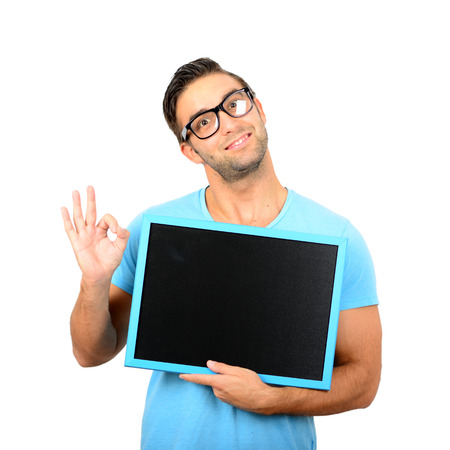 displaying: Happy young man showing and displaying placard ready for your text or product isolated on white background