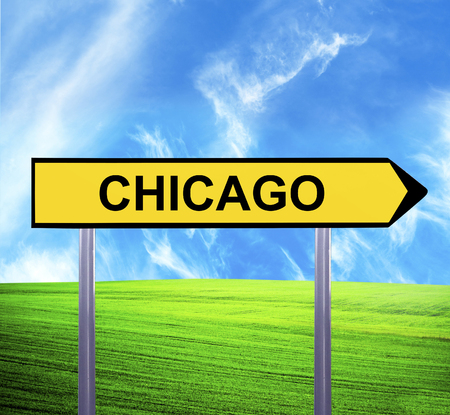 Conceptual arrow sign against beautiful landscape with text - CHICAGO photo
