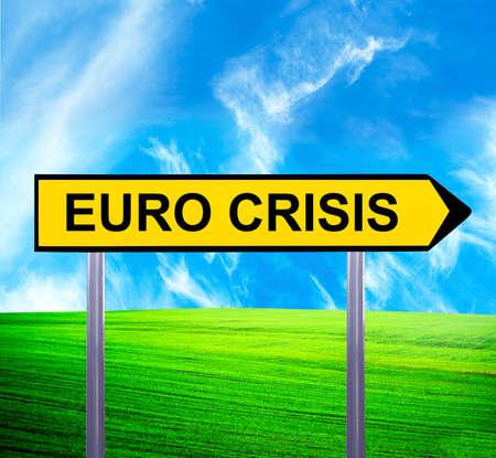 Conceptual arrow sign against beautiful landscape with text - EURO CRISIS photo