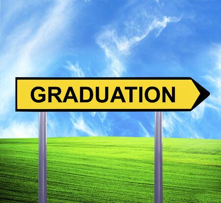 postgraduate: Conceptual arrow sign against beautiful landscape with text - GRADUATION Stock Photo