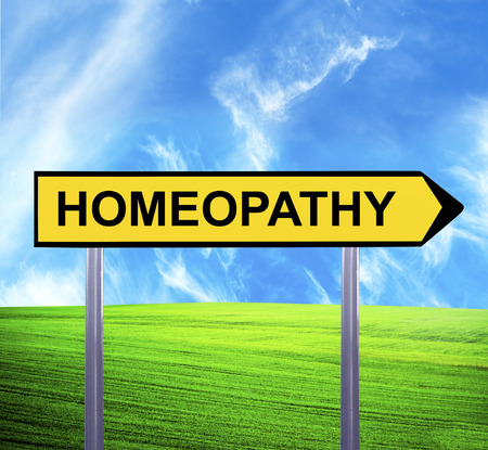 homeopath: Conceptual arrow sign against beautiful landscape with text - HOMEOPATHY Stock Photo