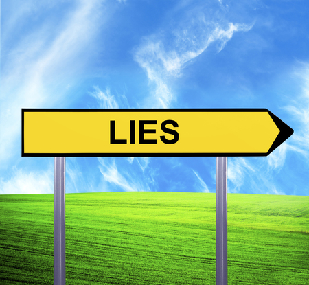 Conceptual arrow sign against beautiful landscape with text - LIES Stock Photo