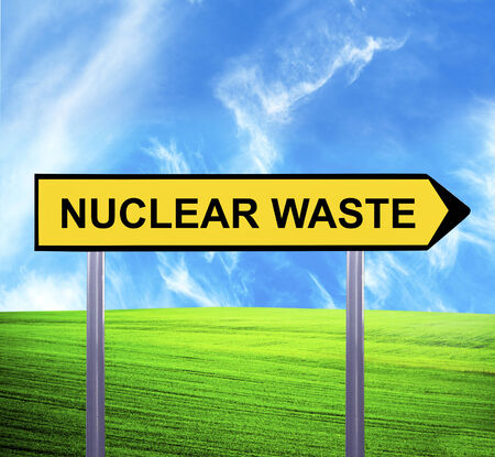 nuclear waste: Conceptual arrow sign against beautiful landscape with text - NUCLEAR WASTE
