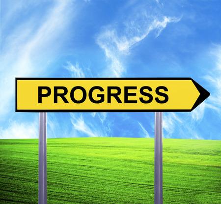Conceptual arrow sign against beautiful landscape with text - PROGRESS photo