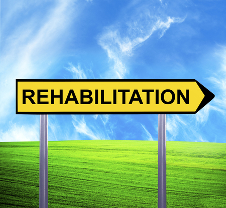 physiotherapist: Conceptual arrow sign against beautiful landscape with text - REHABILITATION