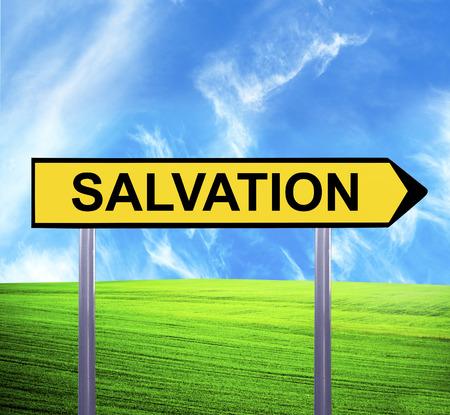 salvation: Conceptual arrow sign against beautiful landscape with text - SALVATION