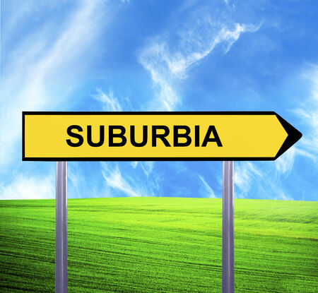 Conceptual arrow sign against beautiful landscape with text - SUBURBIA