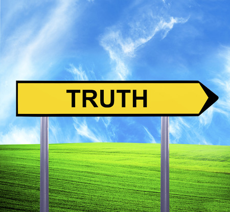 Conceptual arrow sign against beautiful landscape with text - TRUTH photo