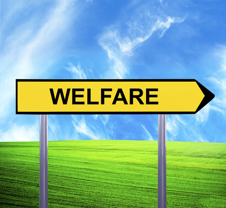penniless: Conceptual arrow sign against beautiful landscape with text - WELFARE Stock Photo