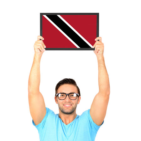 national flag trinidad and tobago: Portrait of a young casual man holding up board with National flag of Trinidad and Tobago