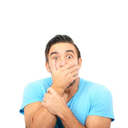 Portrait of man with shock gesture against white background Stock Photo