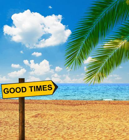 enjoyable: Tropical beach and direction board saying GOOD TIMES Stock Photo