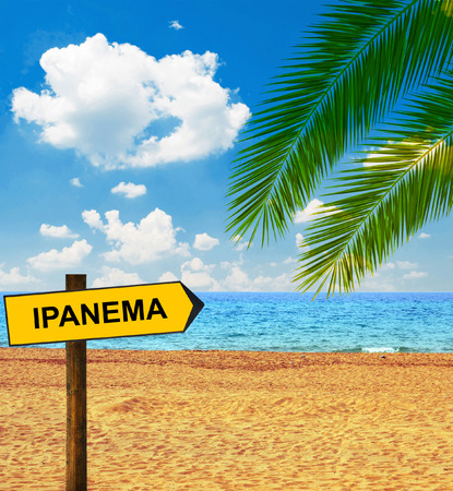accommodating: Tropical beach and direction board saying IPANEMA Stock Photo