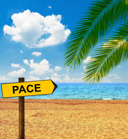 pace: Tropical beach and direction board saying PACE Stock Photo