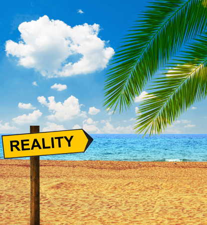 Tropical beach and direction board saying REALITY