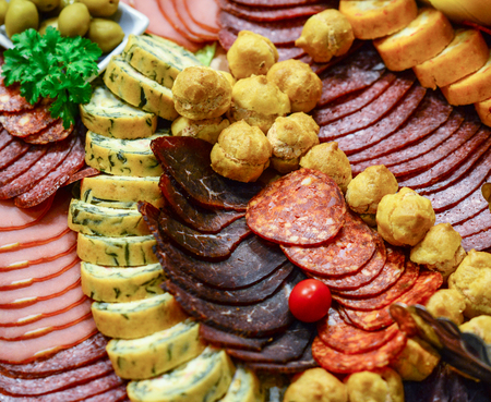 Catering platter with different meat and cheese products photo