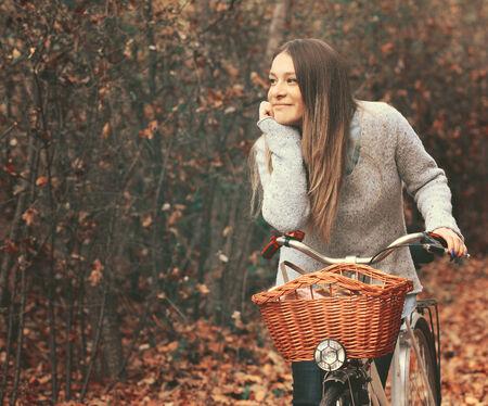 Beautiful woman enjoying nature driving bicycle photo