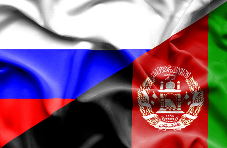 immigrant: Waving flag of Afghanistan and Russia