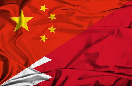 bahrain money: Waving flag of Bahrain and China