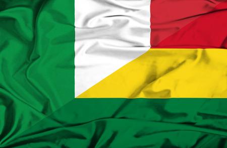 Waving flag of Bolivia and Italy Stock Photo