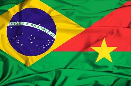 burkina faso: Waving flag of Burkina Faso and Brazil