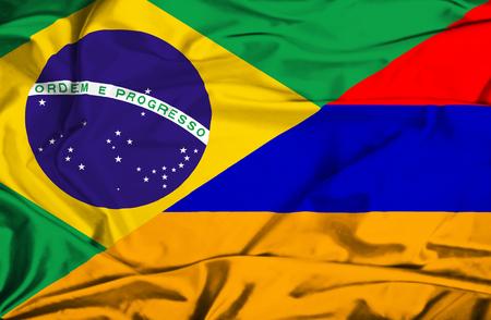 armenia: Waving flag of Armenia and Brazil Stock Photo