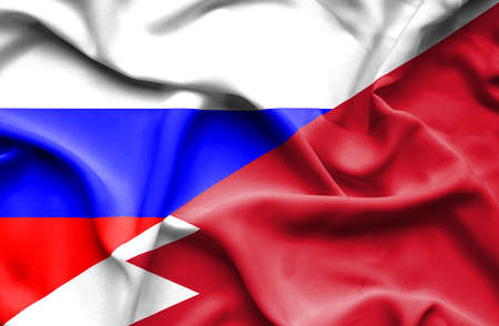 bahrain money: Waving flag of Bahrain and Russia