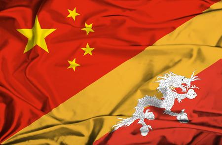 bhutan: Waving flag of Bhutan and China